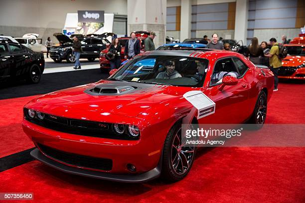 Two boys check out a Dodge Challenger on display at the Washington Auto Show in Washington USA on January 28 2015