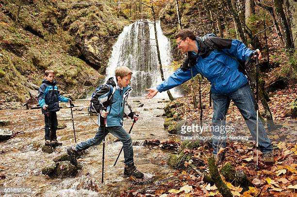 Two Boys Crossing A Brook, Bavaria, Germany, Europe