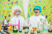 Two boys doing chemical experiments in the laboratory