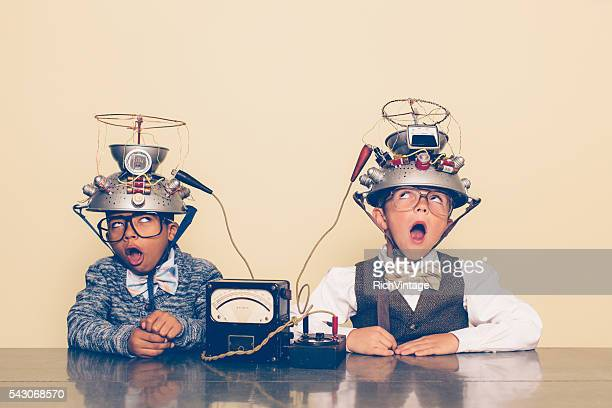 Two Boys Dressed as Nerds Experimenting with Mind Reading Helmets