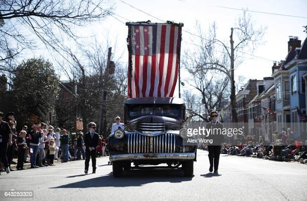 Two boys dressed as Secret Service members walk with the Hard Times Cafe Chili Truck during the annual George Washington Birthday Parade February 20...