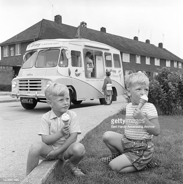 Two boys eating icecreams bought from an Austin ice cream van Hull 20th July 1961