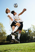 Two Boys Fighting for Soccer Ball