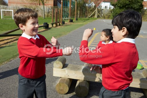 Two Boys Fighting In School Playground Stock Photo ...