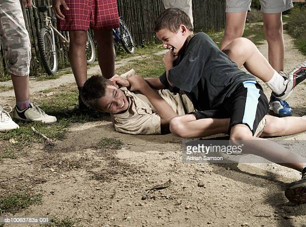 Two boys (10-14) fighting