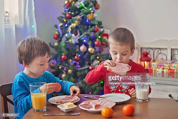 Two boys having breakfast on christmas day