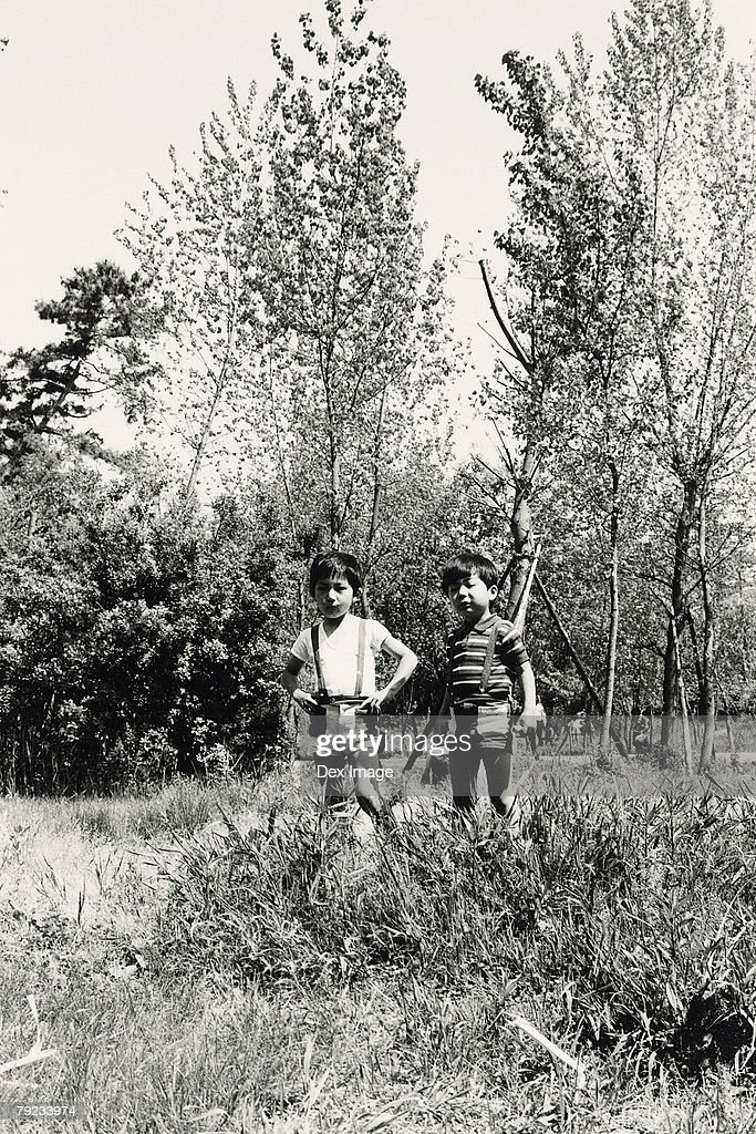 Two boys in a forest : Stock Photo