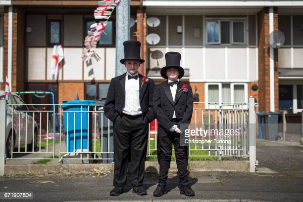 Two boys in costume pose during the Manchester St George's Day parade through the streets on April 23 2017 in Manchester England Various parades have...