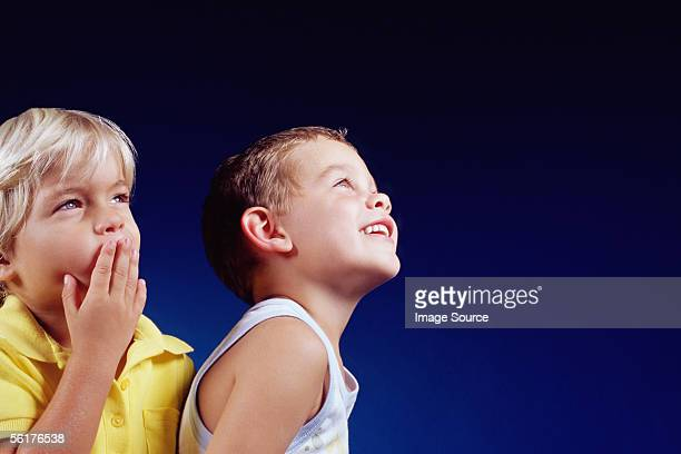 Two boys looking up