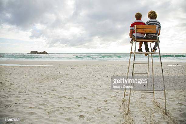 Two boys on lifeguard tower