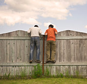 Photo of two boys on the fence.