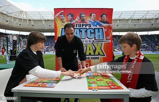 Two boys play the German championship match of the 'Topps Match Attax Trading Card Game' prior to the Bundesliga match between 1899 Hoffenheim and FC...