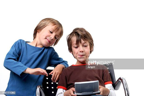 two boys playing a video game white background