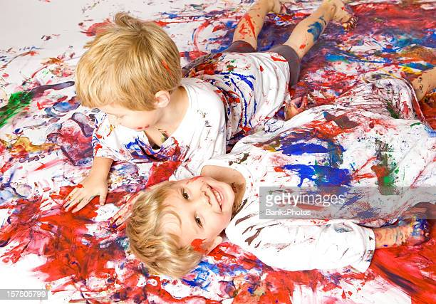 Two Boys Playing in Paint