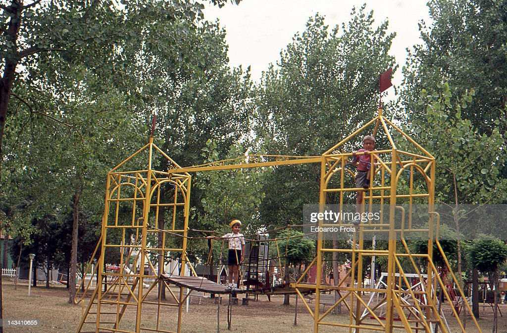 Two boys playing in public park : Stock Photo