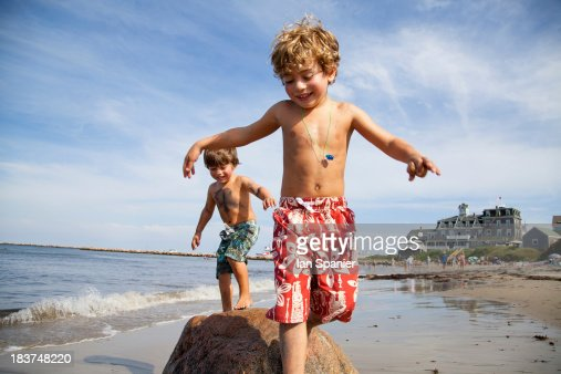Two boys playing on beach : Stock Photo