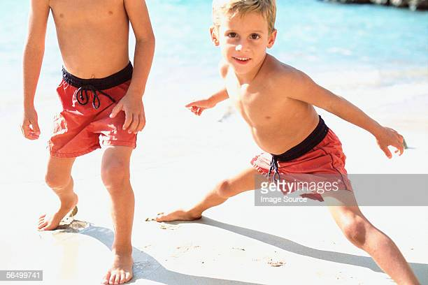 Two boys playing on beach