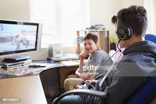 Two boys playing on computer game