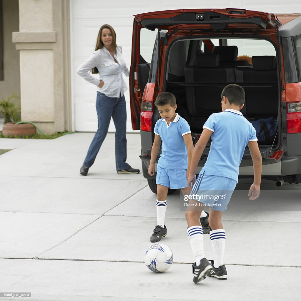 Two boys playing with a soccer ball
