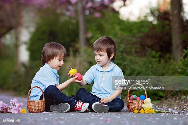 Two boys, playing with easter eggs outdoor