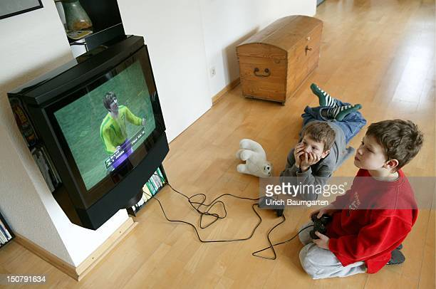 Two boys playing with ' Playstation '