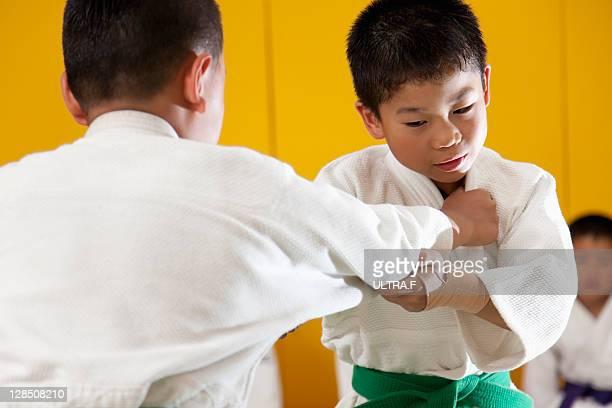 Two boys practising judo