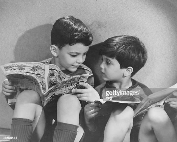 Two boys reading comics circa 1950