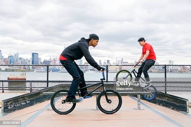 Two boys riding their BMX near NYC