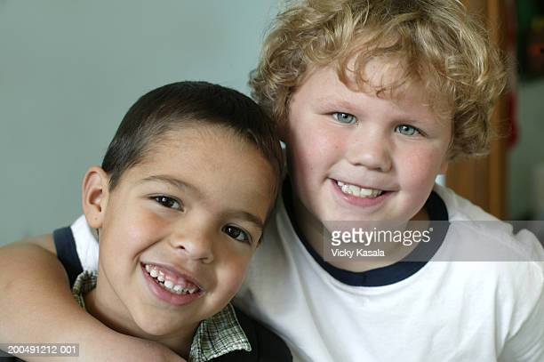 Two boys (6-8) smiling, portrait