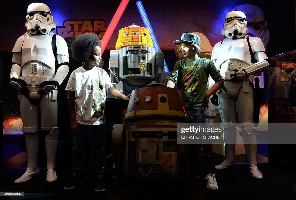 Two boys stand at the Star Wars booth of Lego at the International Toy Fair in Nuremberg, southern Germany, on January 28, 2014. The specialised trade fair runs from January 29 to February 3, 2014. AFP PHOTO / CHRISTOF STACHE