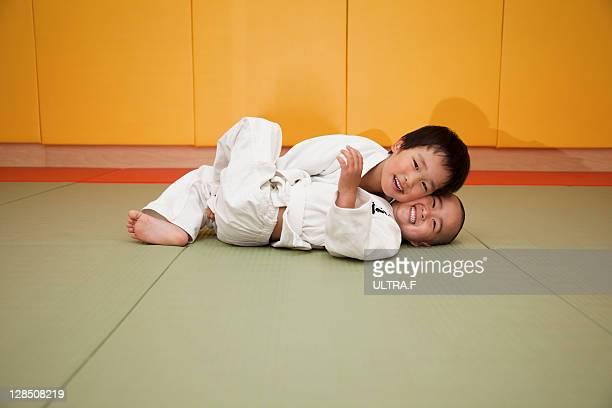 Two boys training Judo