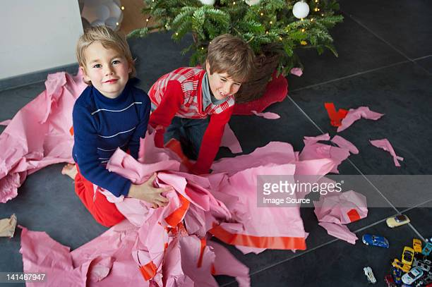 Two boys unwrapping Christmas presents, portrait