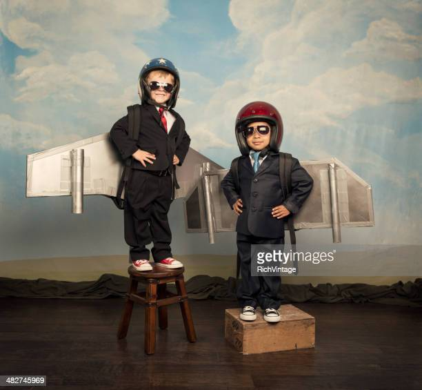 Two Boys Wearing Business Suits and Jetpacks