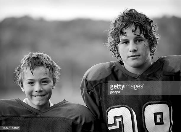 Two Boys Wearing Football Jerseys