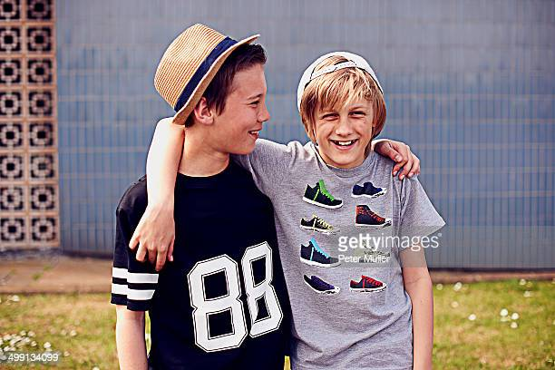 Two boys with arms around each other, portrait