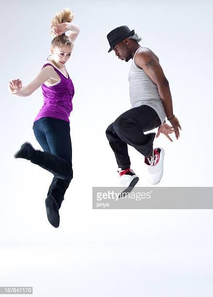 Pausa due ballerini di saltare in aria