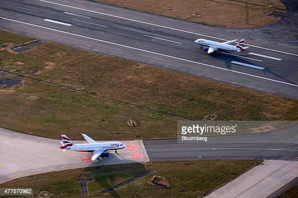 Two British Airways aircrafts operated by British Airways Plc prepare to takeoff from the north runway at London Heathrow Airport in this aerial...