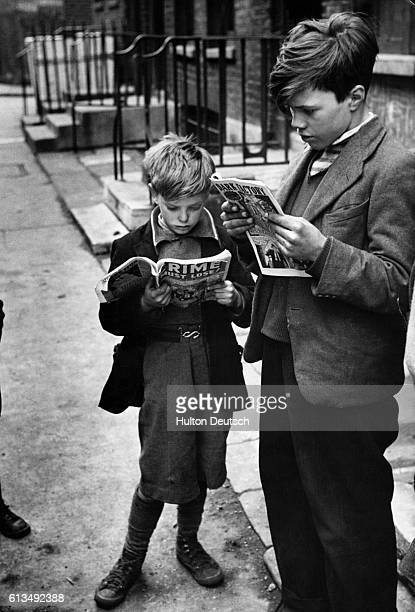 Two British children read imported US comics 1952 The comics lead to concern with Britain that children were being corrupted by their adult content