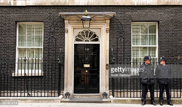 Two British police officers stand guard outside number 10 Downing Street the official residence of Britain's current Prime Minister and leader of the...