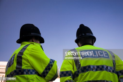 Two British Policemen wearing Traditional Helmets-Click below for more.