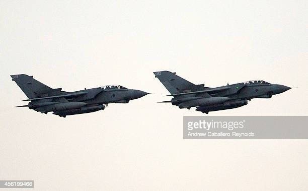 Two British RAF tornado fighter jets land on an airstrip at RAF Akrotiri after returning from a mission over Iraq on September 27 2014 in Limassol...