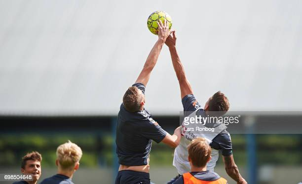 Two Brondby players competing for the ball during the Brondby IF training session at Brondby Stadion on June 20 2017 in Brondby Denmark