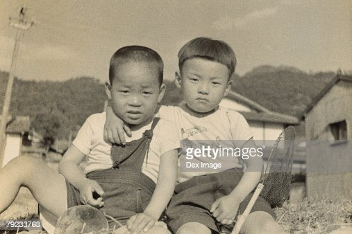 Two brothers at backyard : Stock Photo