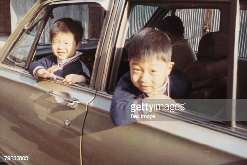 Two brothers in a car : Stock Photo