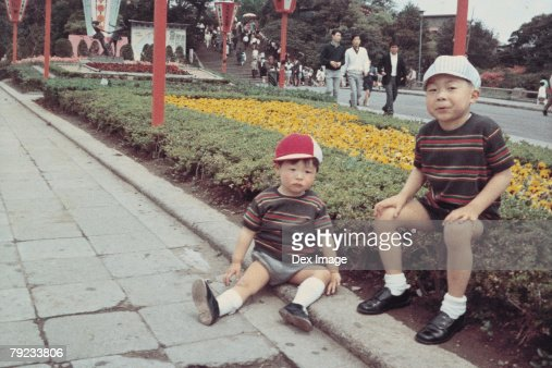 Two brothers in a park : Stock Photo