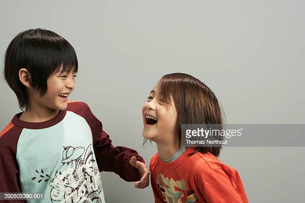 Two brothers (6-9) laughing