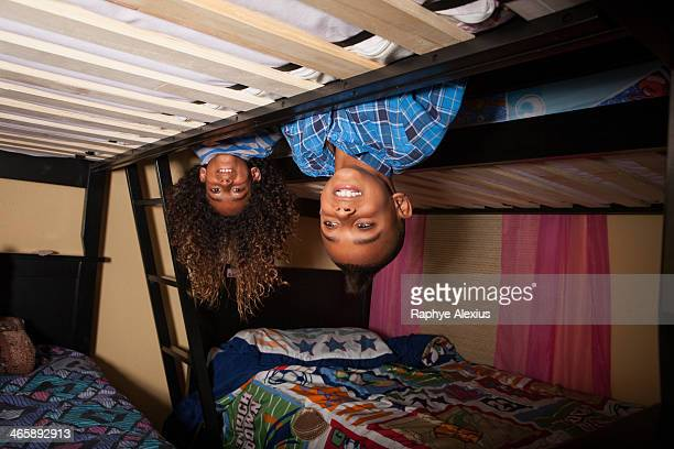 Two brothers leaning over bunkbed