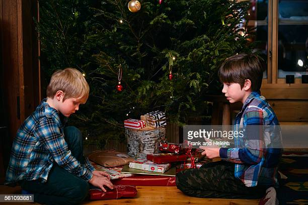 Two brothers opening Christmas presents
