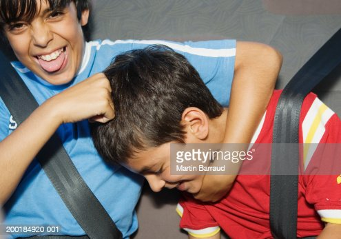 Brothers Fighting In The Back Seat Of The Car