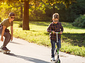 Two brothers skateboarding